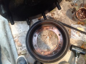 Brake drum gets a coat of copper grease on the rim.